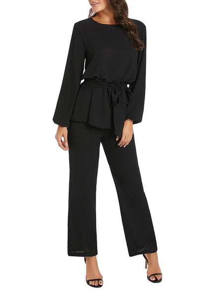 Model wearing black long sleeves slit-back peplum jumpsuit