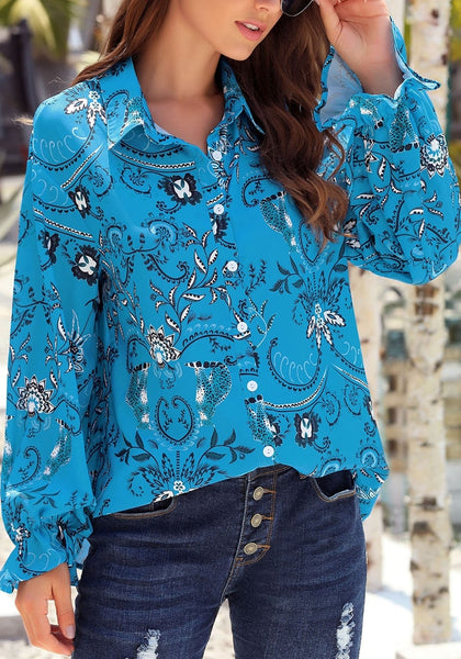Model wearing blue V-neckline boho floral-print button-up loose top