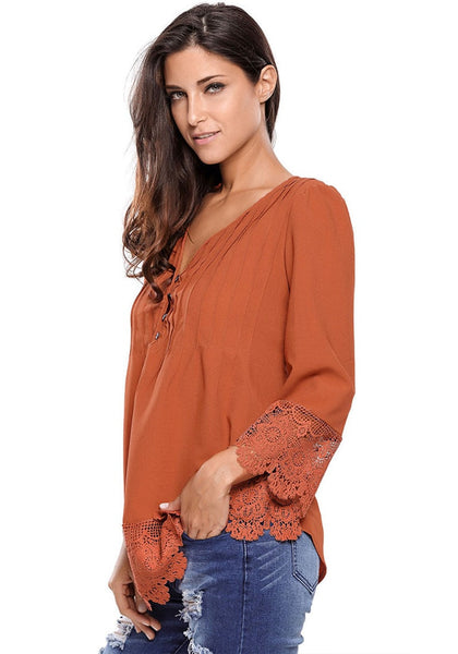 Model wearing brown padded shoulder lace-trim blouse