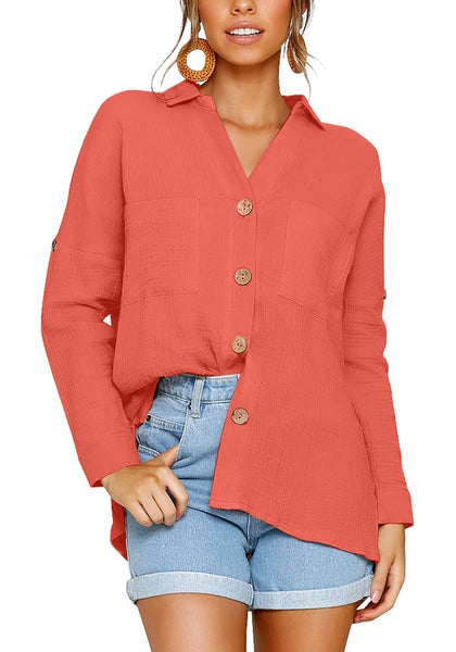 Model wearing coral collared V-neckline cuffed sleeves button-up top
