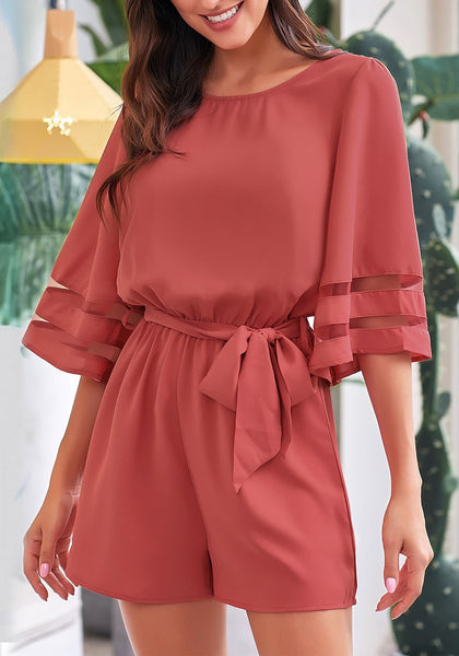 Model wearing coral pink 34 bell mesh panel sleeves belted romper