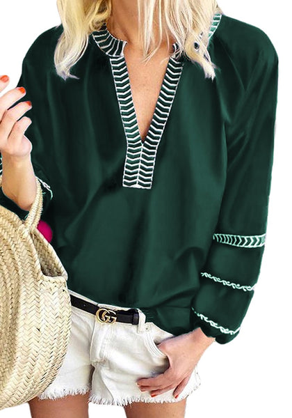 Model wearing green notched V-neckline lantern sleeves boho top