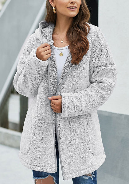 Model wearing grey fuzzy fleece hooded open-front oversized coat