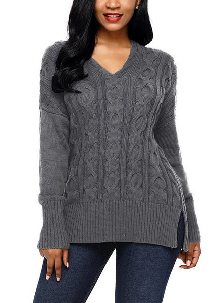 Model wearing grey ribbed cable knit side-slit sweater