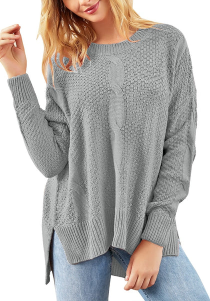 Model wearing grey ribbed knit textured side-slit sweater