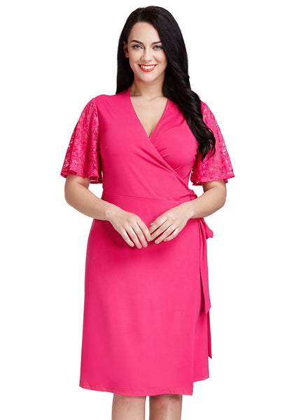 Model wearing hot pink plunge wrap-style dress