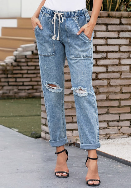 Model wearing light blue drawstring-waist cuffed ripped boyfriend jeans