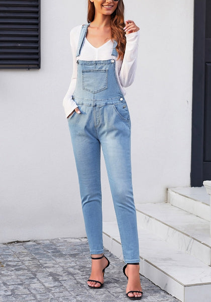 Model wearing light blue rolled hem skinny denim bib overall jumpsuit