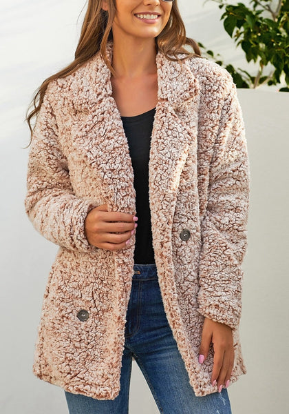 Model wearing light brown notched lapel double breasted fuzzy fleece coat