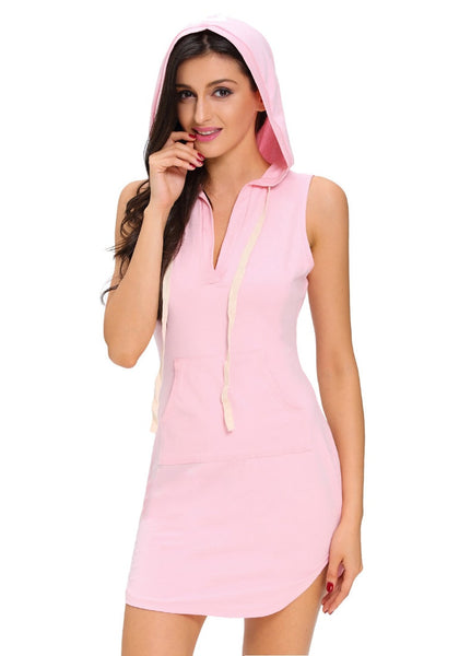Model wearing light pink sleeveless hoodie dress with hood on