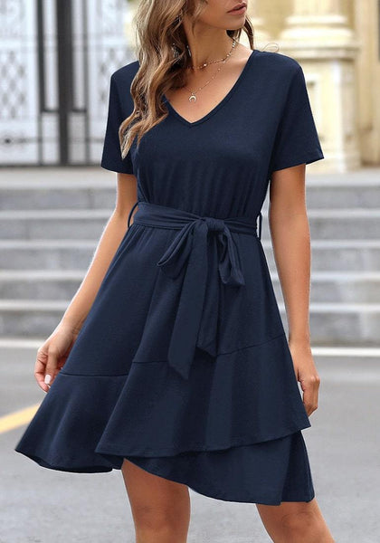 Model wearing navy V-neckline short sleeves belted ruffle dress