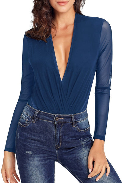 Model wearing navy blue long sleeves surplice neckline sheer mesh bodysuit with her jeans