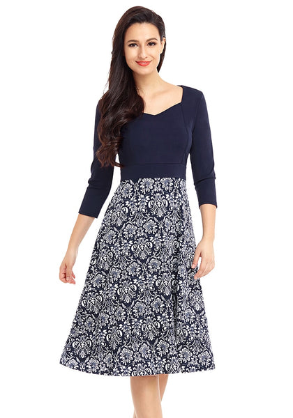 Model wearing navy floral-bottom sweetheart neckline skater dress