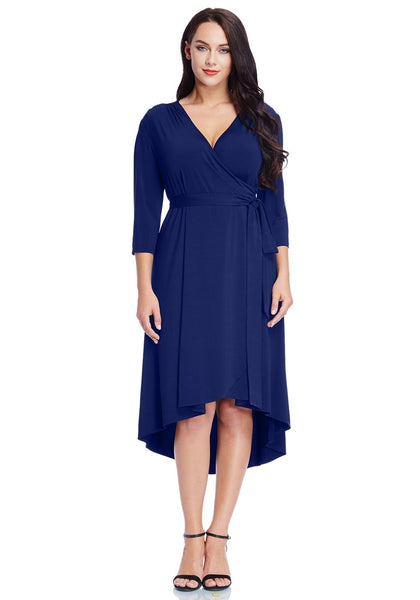 Model wearing plus size royal blue high-low wrap skater dress