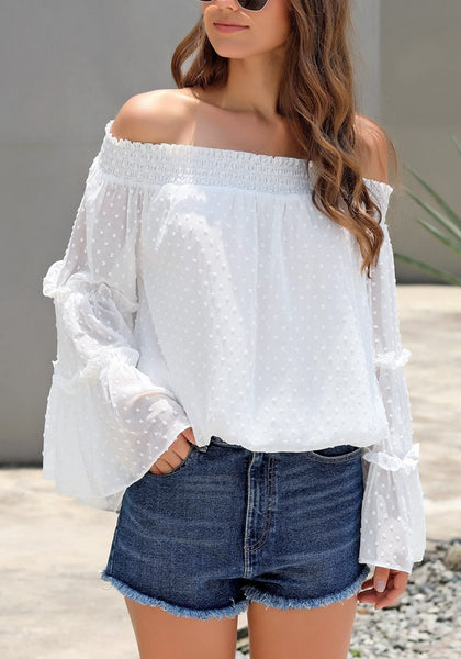 Model wearing white bell sleeves dotted loose off-shoulder top