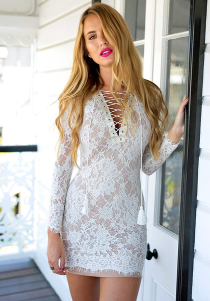 Model wearing white lace-up sheath lace dress