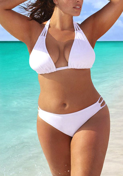 Model wearing white three-straps halter bikini set at the beach