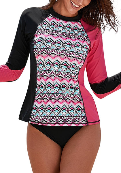 Model wears hot pink geometric-print long sleeves color block rash guard showing details