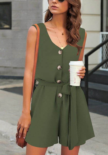 Model poses wearing army green V-neck sleeveless belted button-up romper