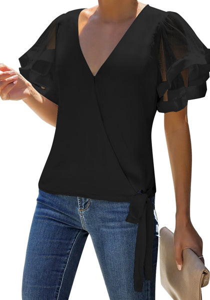 Model poses wearing black V-back mesh butterfly sleeves side-tie wrap top