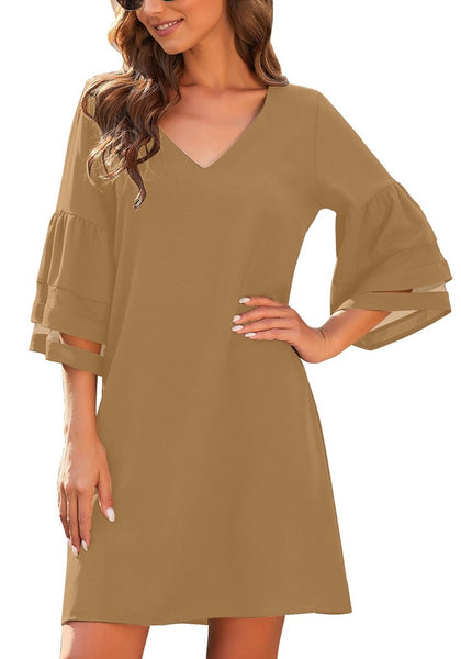 Model poses wearing brown 3-4 mesh sleeves V-neck mini shift dress