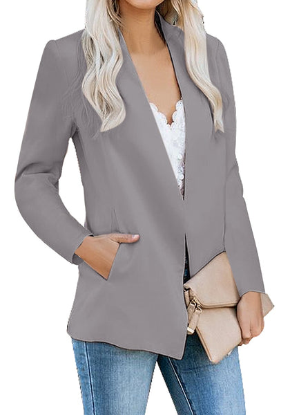 Model poses wearing grey open-front side pockets blazer