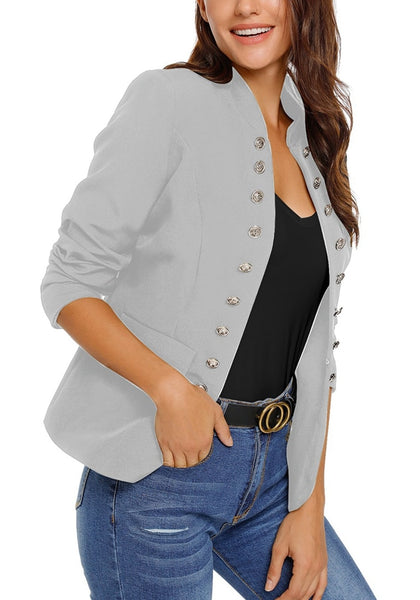 Model poses wearing light grey stand collar open-front blazer