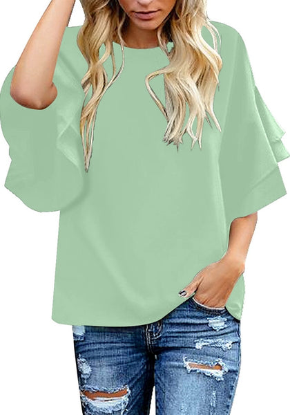 Model poses wearing mint green trumpet sleeves keyhole-back blouse