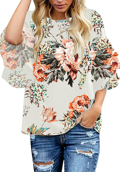 Model posses wearing apricot trumpet sleeves keyhole-back printed blouse