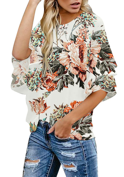 Model wearing apricot trumpet sleeves keyhole-back printed blouse