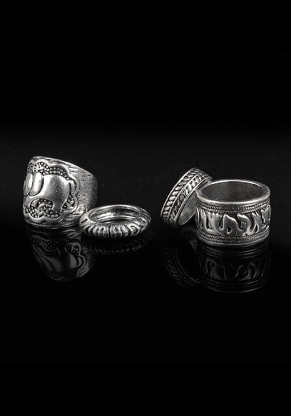 Oxidized silver ring set in black background
