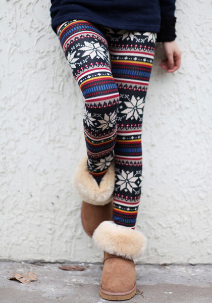 Front view of model in aztec floral leggings