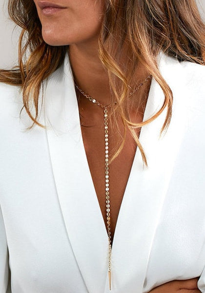 Pretty model in gold disc jockey drop necklace