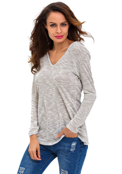 Pretty model in light grey hooded loose knitted top