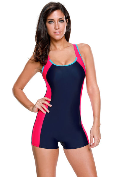 Pretty model in navy and hot pink racerback keyhole maillot swimsuit