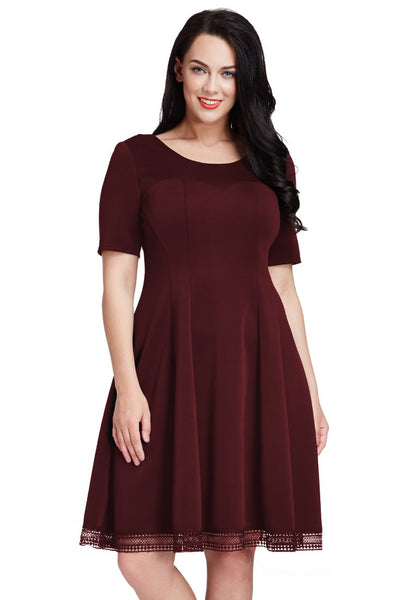 Pretty model in plus size port short-sleeves skater dress