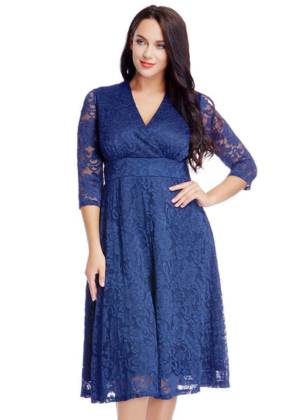 Pretty model in plus size royal blue lace surplice midi dress