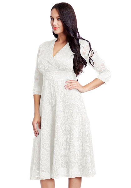 Pretty model in plus size white lace surplice midi dress
