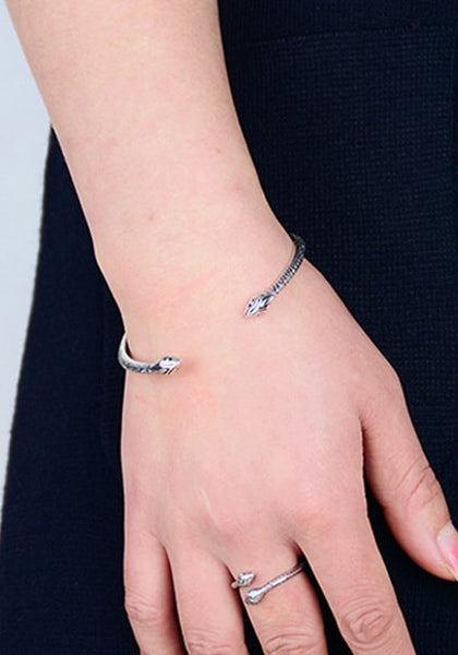 Pretty model in silver two-headed snake cuff bracelet