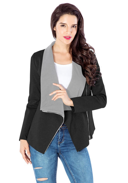 Pretty model poses wearing black oblique zipper draped cardigan