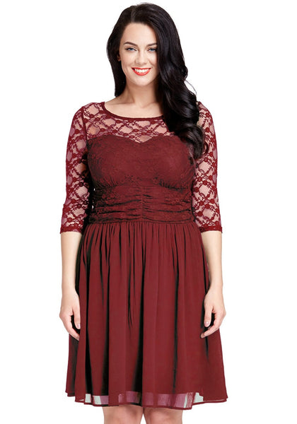 Pretty model poses wearing plus size burgundy lace crop-sleeves skater dress