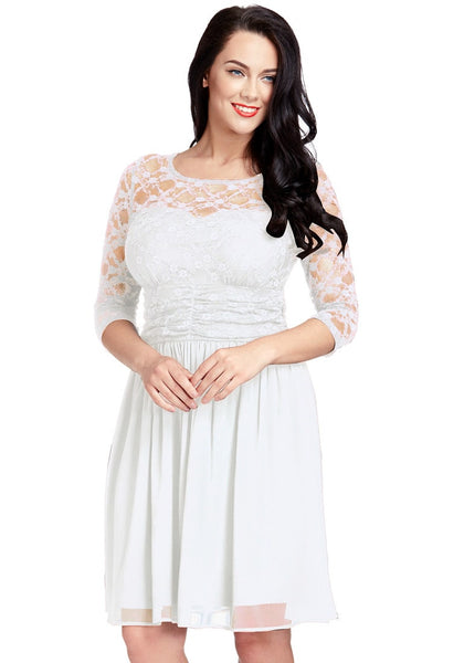 Pretty model poses wearing plus size white lace crop-sleeves skater dress