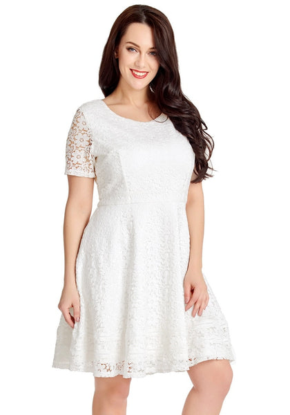 Pretty model poses wearing white floral hollow lace short sleeves skater dress