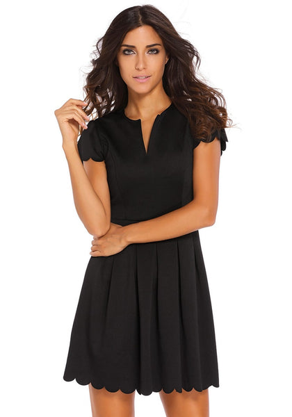 Pretty model wearing black scallop hem skater dress