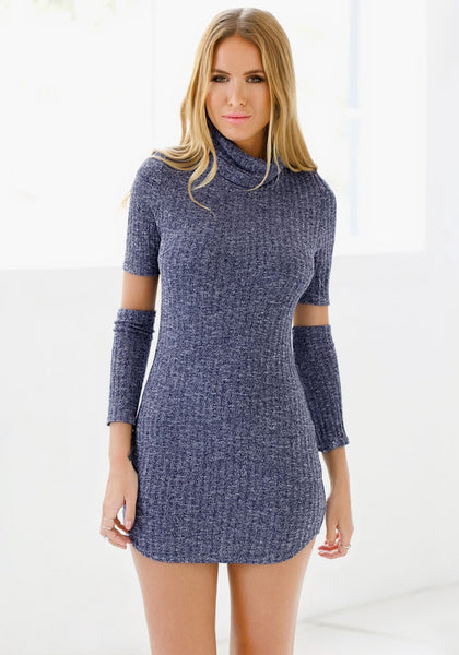 Pretty model wearing blue melange turtleneck tunic