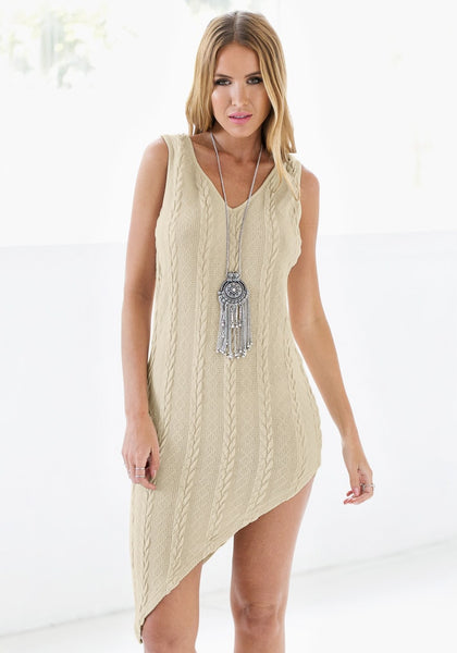 Pretty model wearing braided cable knit asymmetrical dress