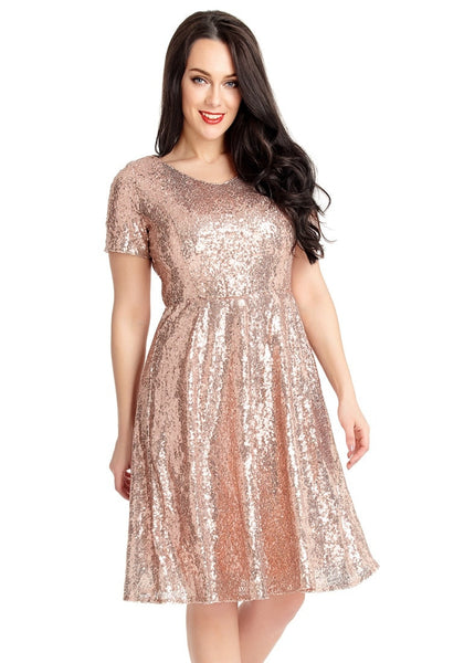 Pretty model wearing champagne sequined short sleeves skater dress