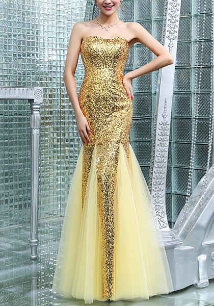 Pretty model wearing gold sequin mermaid evening gown