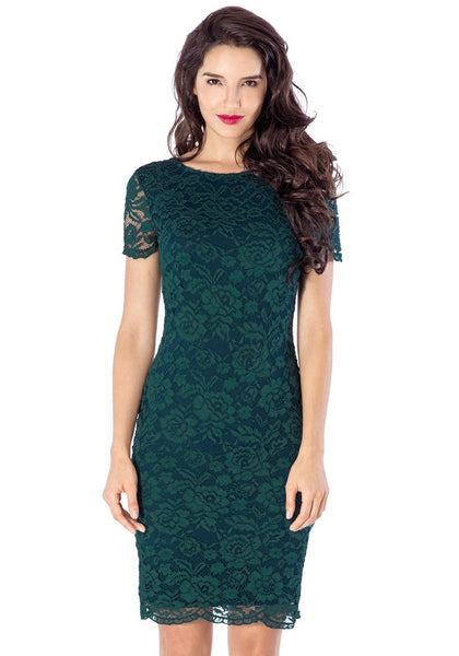 Pretty model wearing green lace overlay shift dress