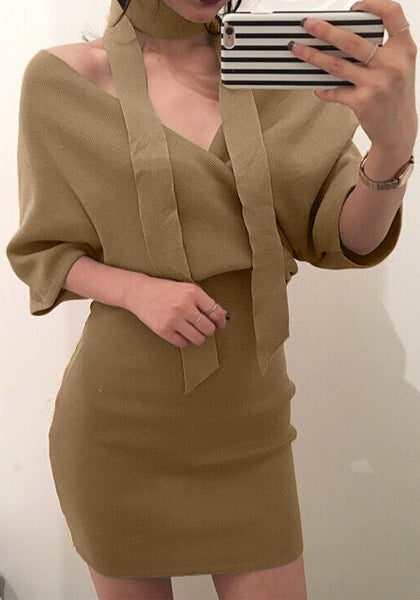 Pretty model wearing khaki wrap pencil dress